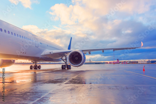 Fototapeta Evening view of a passenger plane wing with engine. obraz