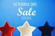 Leinwandbild Motiv Veterans day sale message with red white and blue star decorations