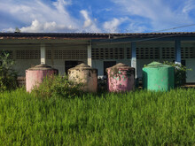 Pink And Green Water Tanks In ...
