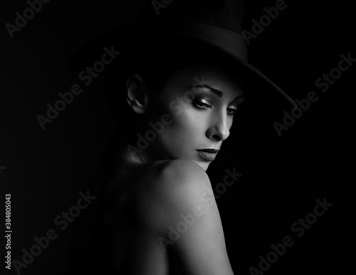 Beautiful makeup woman with elegant healthy neck, nude back and shoulder on black background in fashion hat with empty copy space Canvas