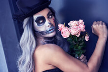 Spooky Portrait Of Woman In Halloween Gotic Makeup Knocking On Door