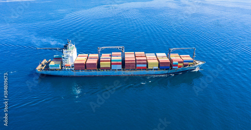 Fotografie, Obraz Cargo ship full loaded with containers, blue sea background
