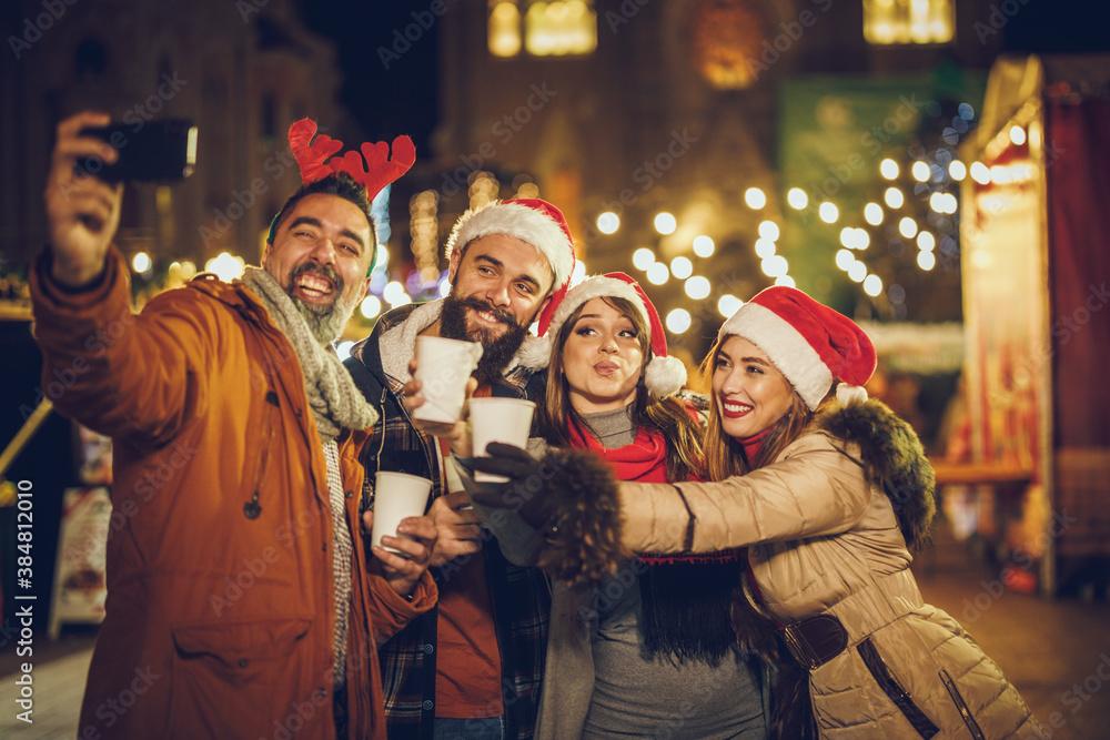 Fototapeta Friends Take Selfie in Downtown At Holiday Night