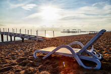Sunbed On The Sand Beach And V...