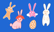 Cute Easter bunnies. Hand drawn vector illustration in doodle style. Festive characters with egg shell. Line art drawing