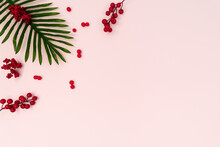 Palm Tree With Red Cherry On Pink Background. Flat Lay, Top View