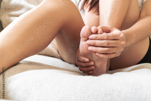 foot ankle injury pain women touch her foot painful, healthcare