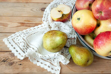 Group Pears And Apples With Napkin On Wooden Background, Closeup, Top View, Autumn Harvest Concept