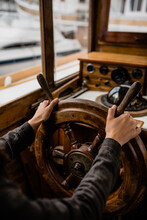 Hands On Helm Of A Boat