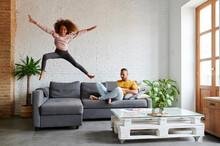 Little Girl Jumping On Her Sofa