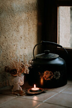 Teapot, Dried Flowers And Candle