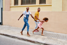 Running Family Walking On A Si...