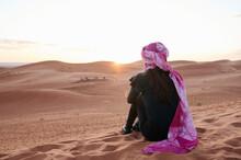 Young Woman Turban Watch Sunse...