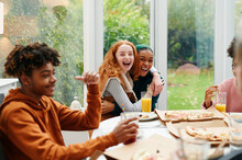 Teens Having A Fun Pizza Party
