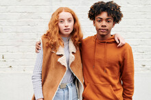 Two Diverse Teens Standing Out...