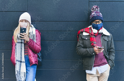 People wearing face mask and respecting social distance durind covid lockdown Fototapeta