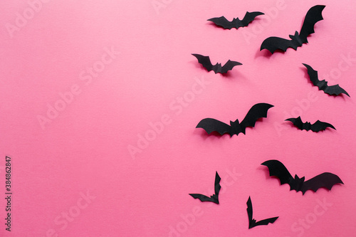 Halloween decorations with bats on pink background. Halloween concept. Flat lay, top view, copy space