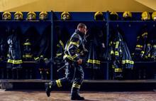 Young Brave Firefighter Runnin...