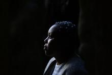 Pensive Portrait Of Black Teen...