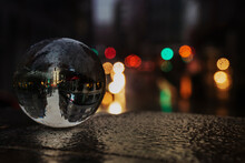 Glass Sphere In A Rainy Street