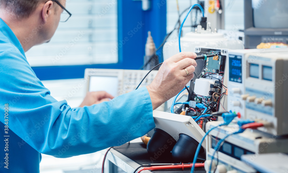 Fototapeta Electronics engineer troubleshooting defects in a hardware product