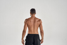 Rear View Of Muscular Man With...