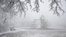 Playground In Winter Covered W...