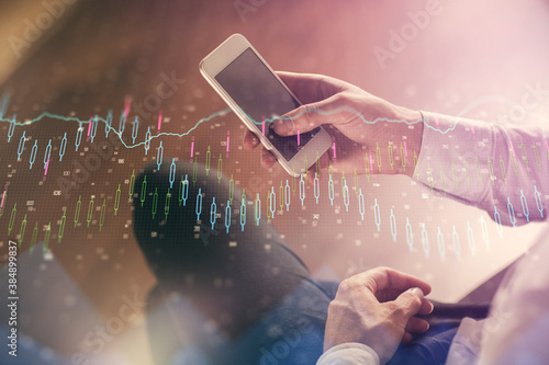 Fototapety, obrazy: Double exposure of man's hands holding and using a digital device and forex graph drawing. Financial market concept.
