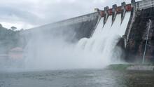 Water Flowing Over Floodgates Of A Dam,Khun Dan Prakan Chon Dam In Nakhon Nayok Province Thailand Dam Of Hydroelectric Power.