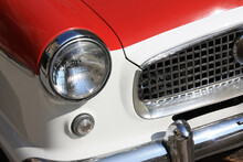 Right Front Grill Of Red And White Car