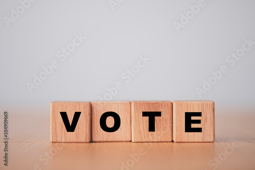 Fototapeta Vote and election concept, Vote wording print screen on wooden cubes block
