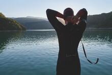 Triathlon Athlete Starting Swi...