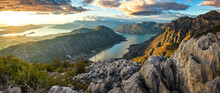 View To Kotor Bay From Mountain Serpentine Road Above The Sky With Clouds At Sunset.