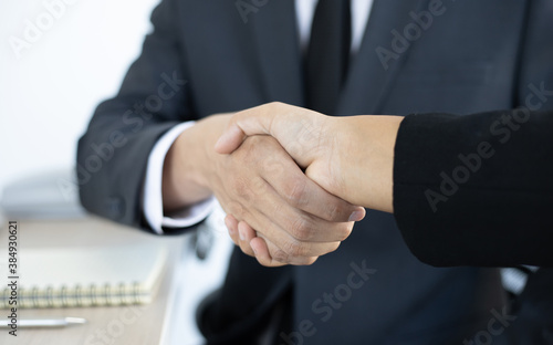 Fototapety, obrazy: Employee wearing a black suit shaking hands