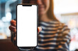 canvas print picture - Mockup image of a beautiful asian woman holding and showing a mobile phone with blank white screen