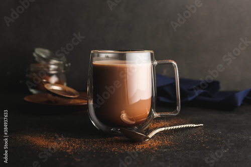Fototapeta Glass cup of tasty cocoa drink on table