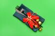 Leinwandbild Motiv Composition with cutlery for Christmas table setting on color background