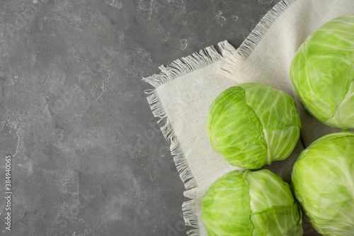 Ripe white cabbage on grey table, flat lay. Space for text Canvas Print