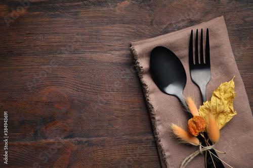 Obraz na płótnie Seasonal table setting on wooden background, space for text