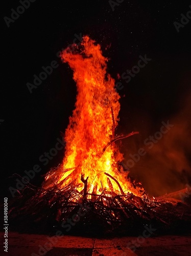 фотография Large yellow orange red flame of hot fire burns in night