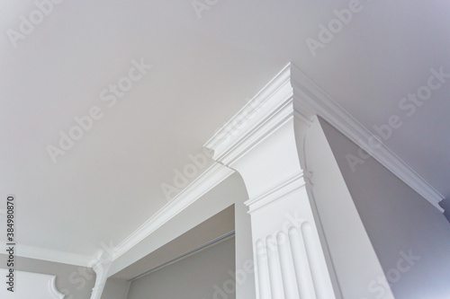 Detail of corner ceiling with intricate crown molding. Canvas-taulu