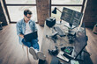 Above high angle view of his he nice attractive focused guy geek expert working remotely typing coding calculating game development dev at modern industrial home office work place station