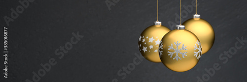 Obraz na plátně Gold colored christmas baubles with different design hanging in front of a black background