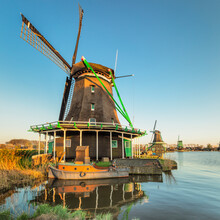 Windmill And Boat On Zaan River, Open-air Museum, Zaanse Schans, Zaandam, North Holland, Netherlands