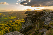 View Of Lone Piper At At Sunset On Curbar Edge, Curbar, Hope Valley, Peak District National Park, Derbyshire, England, United Kingdom