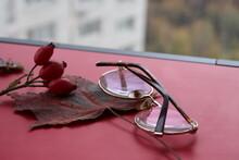 Red Maple Leaf, Rose Hips And Glasses On Laptop Cover, Remote Work, Freelancer