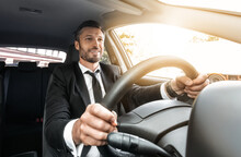 Happy Rich Businessman In Suit Driving Car