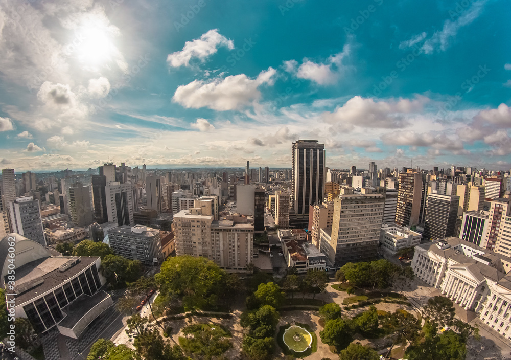 Fototapeta Aerial wide-angle landscape view of urbanized center with colorful skyscrapers in the morning - Santos Andrade Square - Curitiba, capital of Paraná State, Brazil