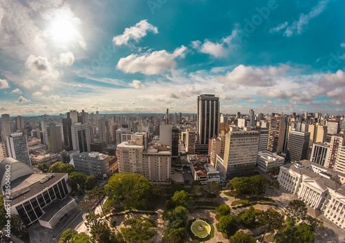 Fotomural Aerial wide-angle landscape view of urbanized center with colorful skyscrapers i