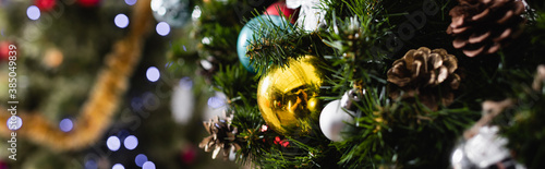 Fotografie, Obraz Panoramic shot of decorated spruce with christmas balls and pine cones